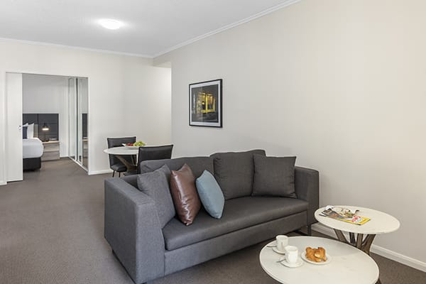 comfy living room at 1 Bedroom executive apartment of Oaks 212 Margaret brisbane hotel