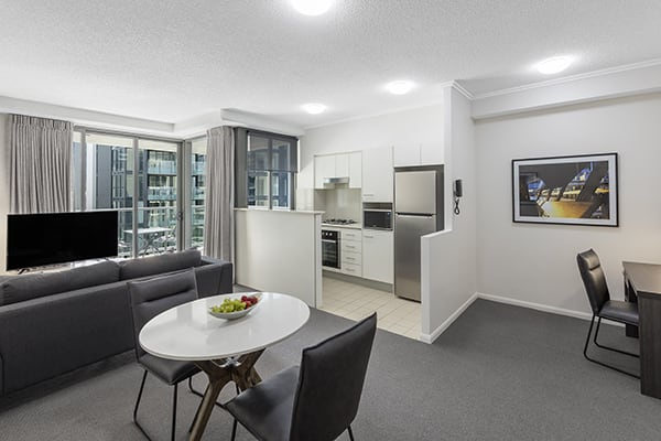 kitchen, living and dining area at 1 Bedroom executive apartment of Oaks 212 Margaret brisbane hotel