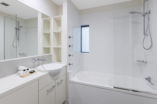 clean bathroom with bathtub at oaks 212 margaret 2 bedroom river view brisbane hotel