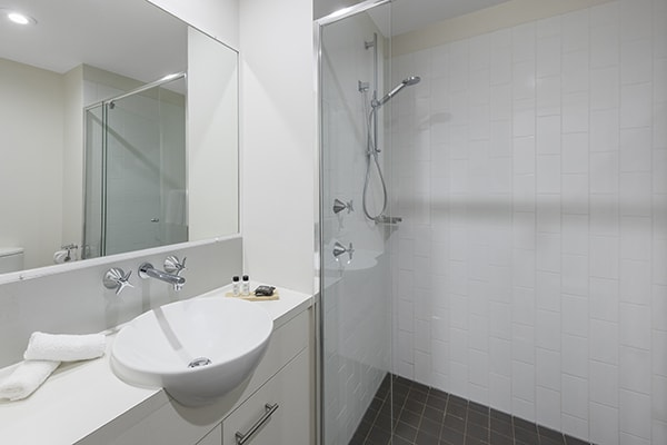 clean bathroom with walk-in shower at oaks 212 margaret 2 bedroom river view brisbane hotel