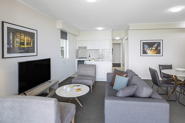 spacious and comfortable living room at oaks 212 margaret 2 bedroom river view brisbane hotel