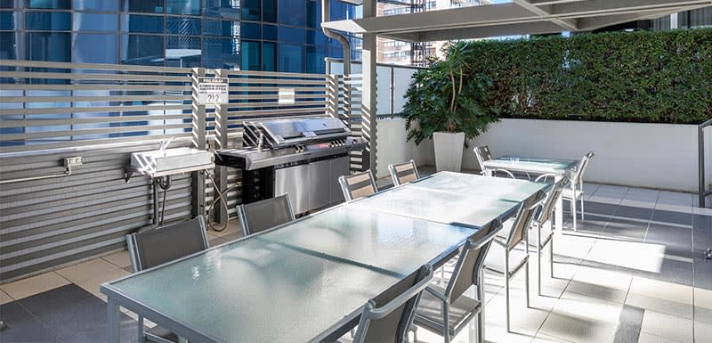 Outdoor barbeque area of Brisbane city hotel