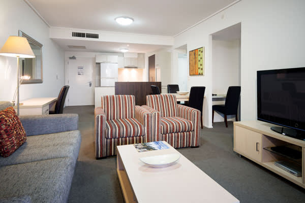 large living room in 1 bedroom executive apartment at Oaks Aurora hotel