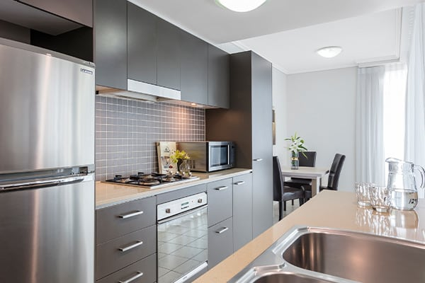fully equipped kitchen at Oaks Brisbane Casino Tower Suites 1 Bedroom Apartment