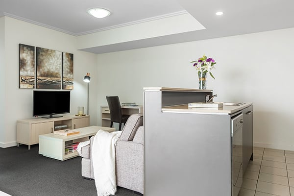 open living room and kitchen area at Oaks Brisbane Casino Tower Suites 1 Bedroom Apartment