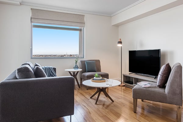 living room with city view at Oaks Brisbane Casino Tower Suites one bedroom executive