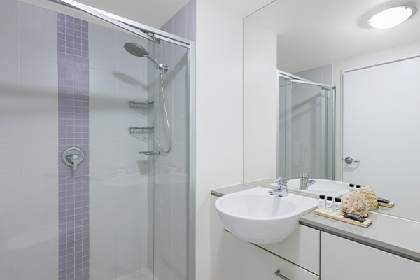 shower room at 2 bedroom apartment with shower and storage space at Oaks Casino Towers hotel in Brisbane city