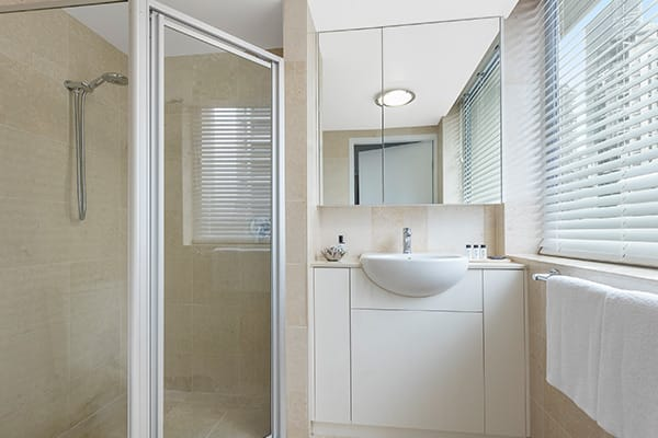 en suite bathroom at 2 bedroom apartment with shower and storage space at Oaks Casino Towers hotel in Brisbane city