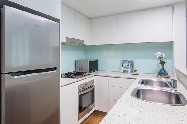 kitchen in 2 bedroom hotel apartment with fridge and microwave close to Treasury Casino in Brisbane CBD