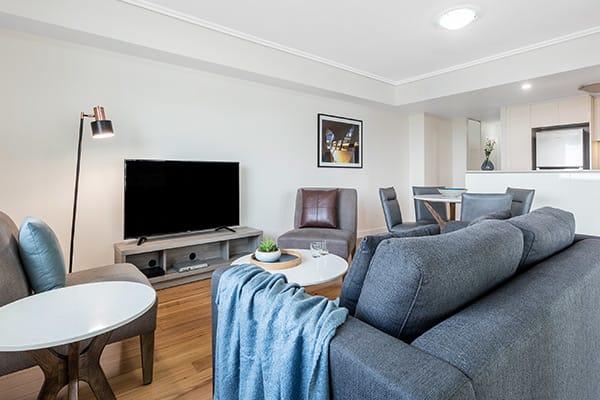 modern living room at Oaks Brisbane Casino Tower Suites 2 Bedroom River View