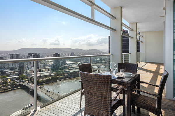 Brisbane city hotels large hotel balcony at daylight with views of Brisbane River at Oaks Casino Towers 3 bedroom apartment
