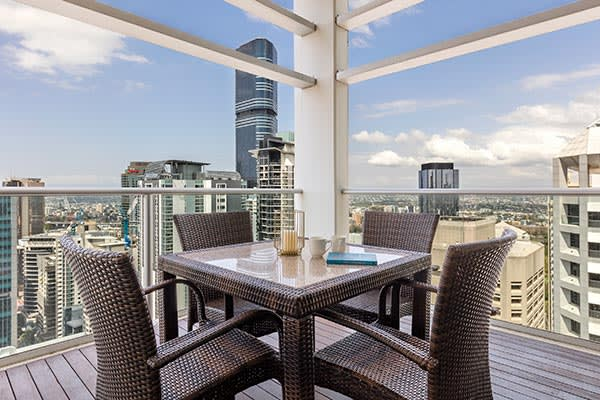 outdoor furniture at the spacious balcony of Oaks Brisbane Casino Tower Suites 3 Bedroom Apartment