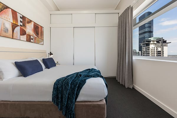 Oaks Brisbane Casino Tower Suites 3 Bedroom Apartment Bedroom three with queen sized bed and nice city view