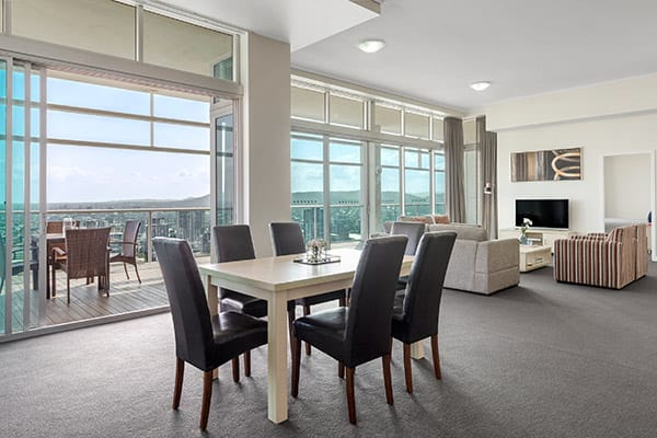 spacious living room and dining room in 3 bed hotel apartment near Treasury Casino in Brisbane city centre