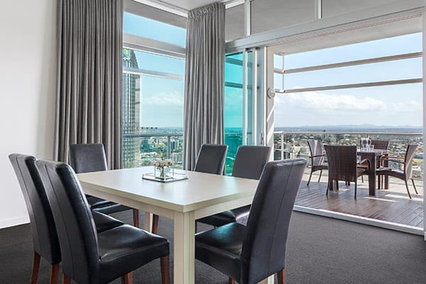 large penthouse balcony and living room area for entertaining at Oaks Casino Towers hotel in Brisbane city