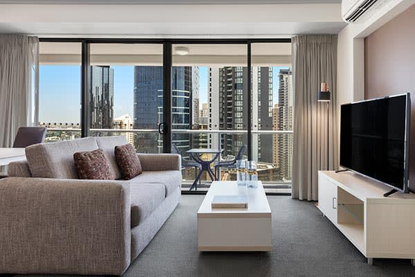 Oaks Brisbane Felix Suites 1 Bed Apartment Living Room with nice city view from the balcony