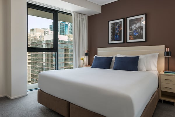 Bedroom with nice city view at Oaks Brisbane Felix Suites 1 Bed Apartment