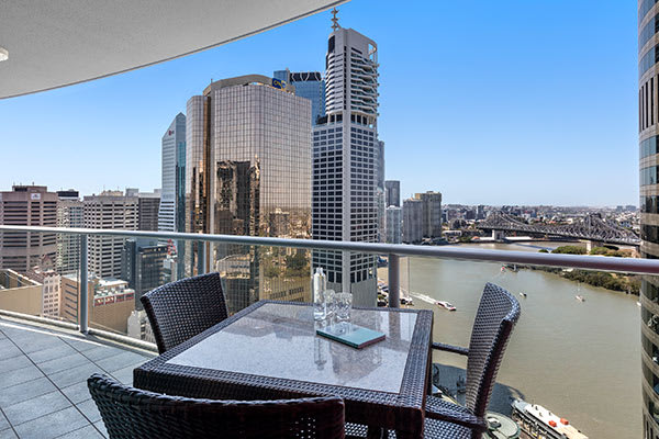 Brisbane CBD accommodation with hotel balcony with views of Story Bridge and Brisbane river at Oaks Felix hotel Brisbane city