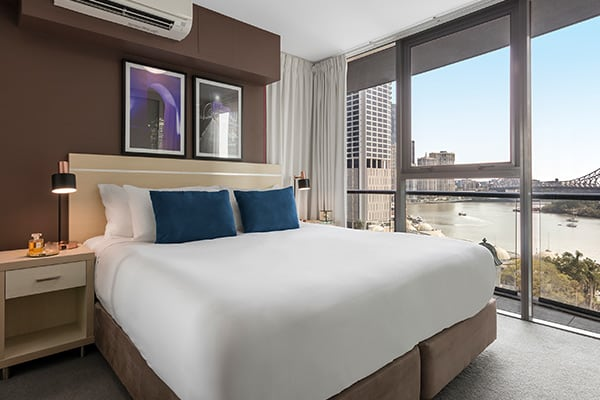 bedroom with views of Story Bridge at Oaks Felix hotel Brisbane city