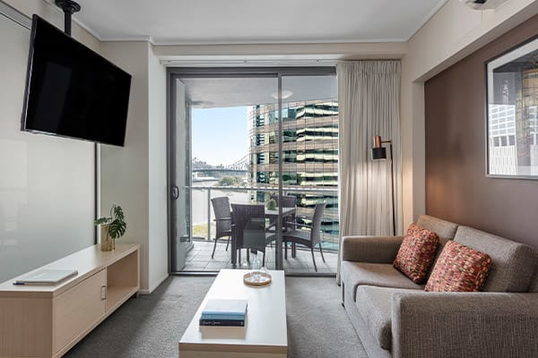 Living Room next to a balcony with city view at Oaks Brisbane on Felix Suites 1 Bedroom Executive