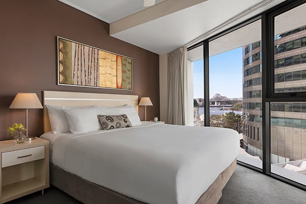 Oaks Brisbane Felix Suites 2 Bed Apartment Bedroom with king sized bed and nice view and story bridge and Brisbane river