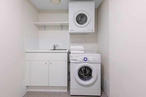 washing machine and dryer at Oaks Brisbane Felix Suites 2 Bed Apartment