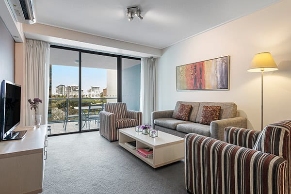 Spacious living space and balcony at Oaks Brisbane Felix Suites 2 Bed Apartment
