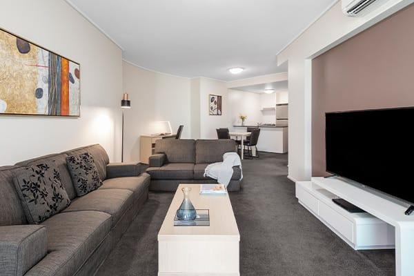 living room and open kitchen at Oaks Brisbane on Felix Suites 2 Bedroom