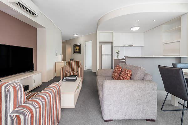 Oaks Brisbane on Felix Suites 2 Bedroom Story Bridge View Living Room and kitchen