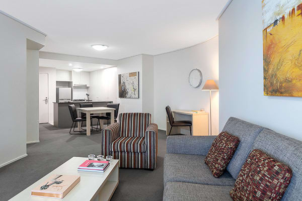 spacious living room with desk for corporate travellers to do work whilst on business trip to Brisbane city