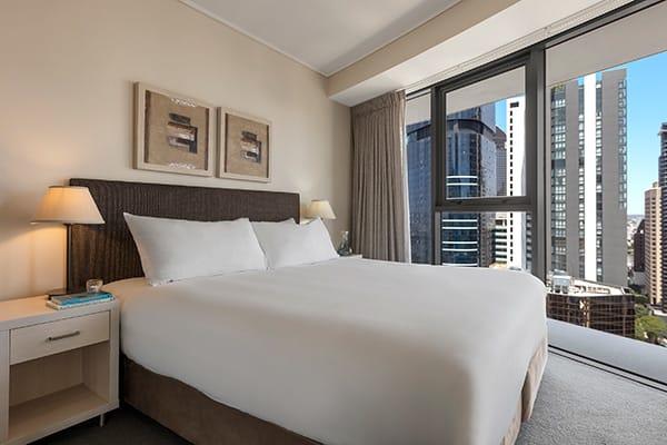 Oaks Brisbane Felix Suites 3 Bed Apartment Bedroom with city view