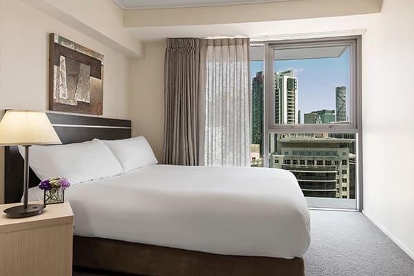 Oaks Brisbane Felix Suites 3 Bed Apartment Bedroom 2 with city view