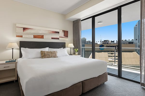 Oaks Brisbane Felix Suites 3 Bed Apartment Bedroom 3 with a private balcony attached and city view