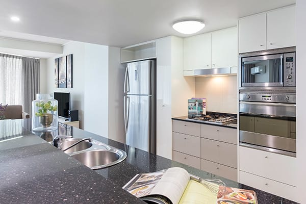 fully equipped kitchen at Oaks Brisbane Felix Suites 3 Bed Apartment Kitchen