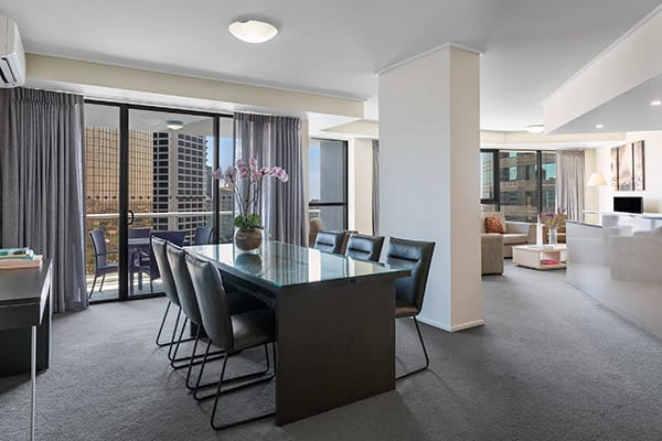 Spacious dining and living room at Oaks Brisbane Felix Suites 3 Bed Apartment