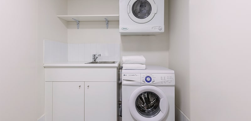 washing machine and dryer at Oaks Brisbane Felix Suites 2 Bed Apartment Laundry