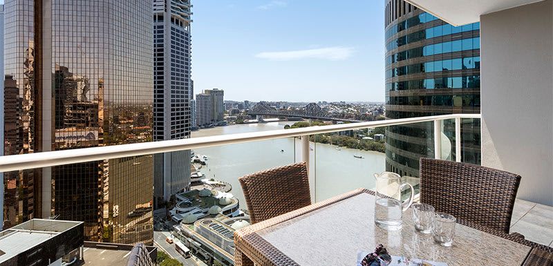 large balcony with views of Story Bridge and Brisbane river at Oaks Felix hotel Brisbane city centre