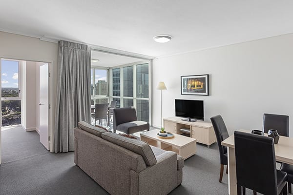 Lounge room with free wi-fi and air con inside 2 bedroom hotel apartment Brisbane CBD
