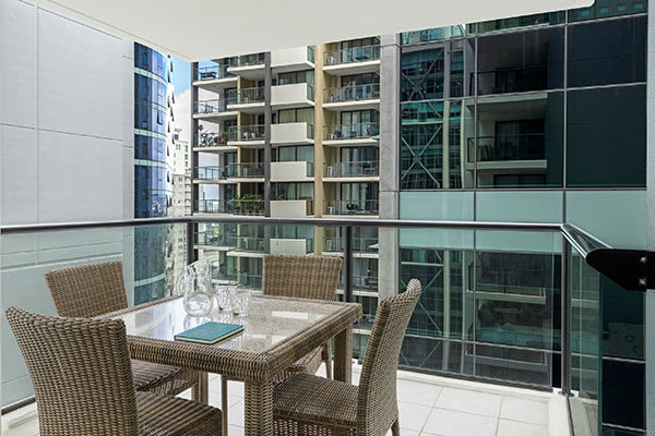 iStay River City two bedroom balcony with outdoor furniture