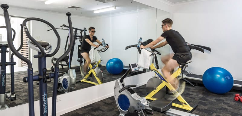 hotel guest using fully equipped gymnasium while on business trip to Brisbane staying at Oaks Lexicon Apartments