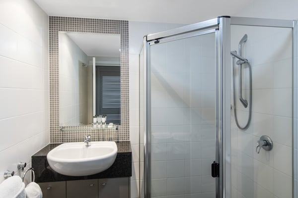 en suite bathroom with large shower and clean towels at Oaks Mews hotel in Bowen Hills, Brisbane, Queensland