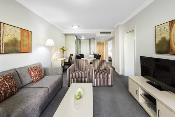 large living room at 2 bedroom apartment at Oaks Mews hotel with air conditioning at foxtel
