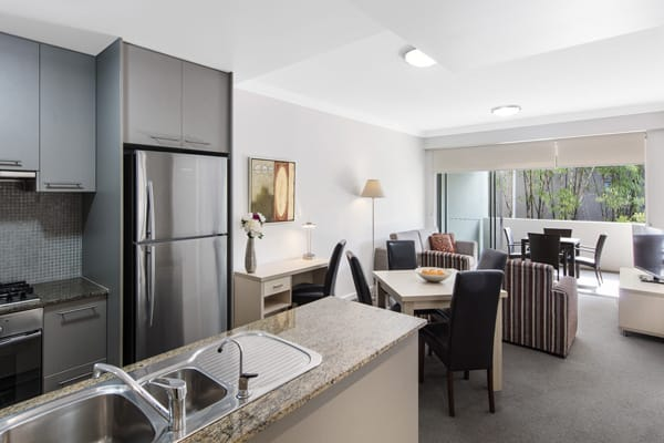 kitchen and living room area in affordable 2 bedroom hotel apartment in Bowen Hills Brisbane