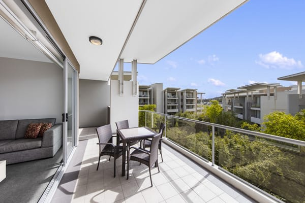 large Bowen Hills Hotels with balcony table and chairs in 2 bedroom apartment at Oaks Mews, Brisbane