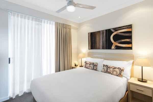Affordable Bowen Hills Hotels 2 bed executive apartment bedroom with lots of storage space and ceiling fan in Brisbane