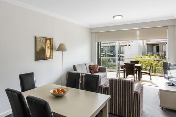 spacious living room area in 2 bedroom apartment with balcony at Oaks Mews hotel in Bowen Hills, Brisbane