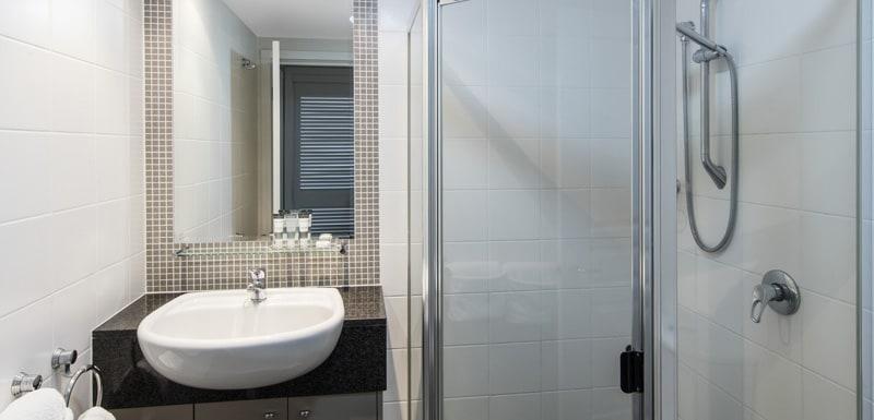 large shower and basin in 3 bedroom apartment en suite bathroom at Oaks Mews hotel in Bowen Hills, Brisbane
