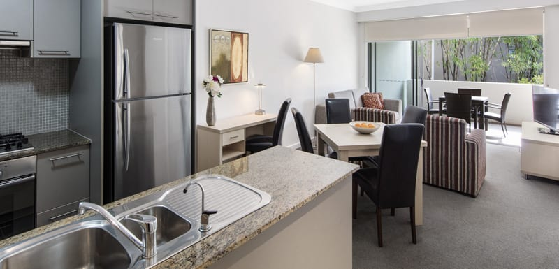open plan kitchen and living room area in Oaks Mews affordable 3 bedroom apartments in Bowen Hills, Brisbane