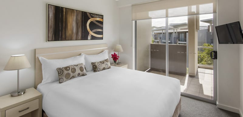 hotel bedroom in 3 bed apartment with balcony and TV in Bowen Hills at Oaks Mews apartments, Brisbane
