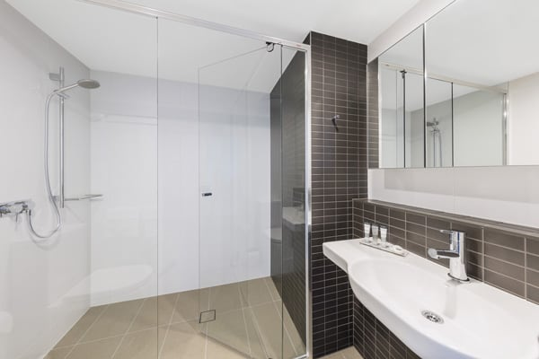 en suite bathroom with large shower, toilet and fresh towels at The Milton Brisbane hotel